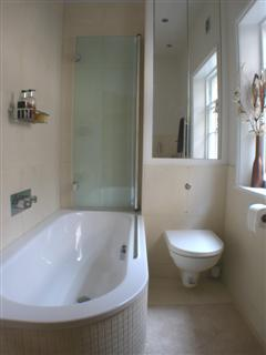 bathroom with shelving and tiles
