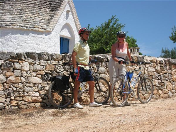 Mark and Mary stand by their bikes in Puglia