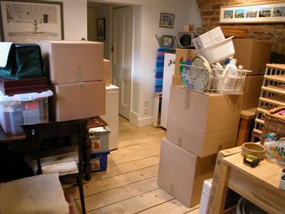 Breakfast room full of packing boxes