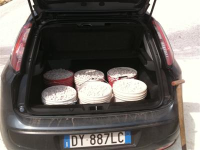 tubs of gravel in the boot of a Fiat Punto
