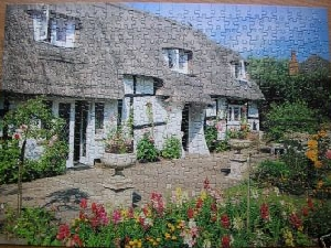 completed jigsaw of thatched cottage, hampshire