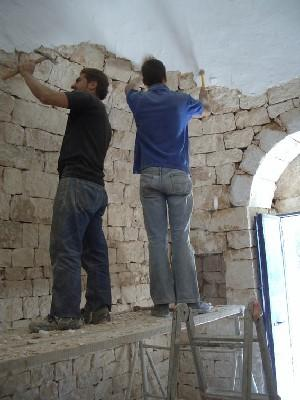 The lads chip away at the interior plaster