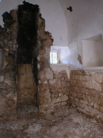 Bathroom stripped to reveal old chimney