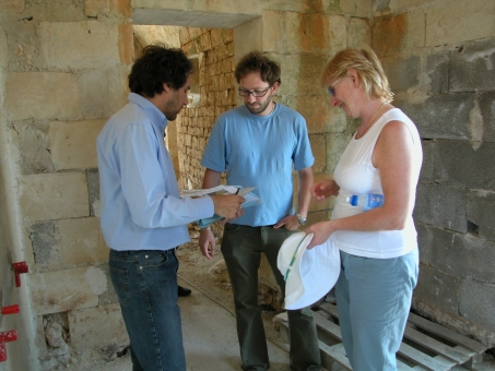 Mary, Daniele and friend discuss kitchen layout