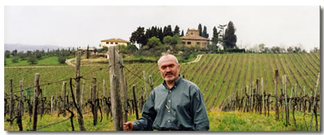 Guiseppi Turi in front of a vineyard